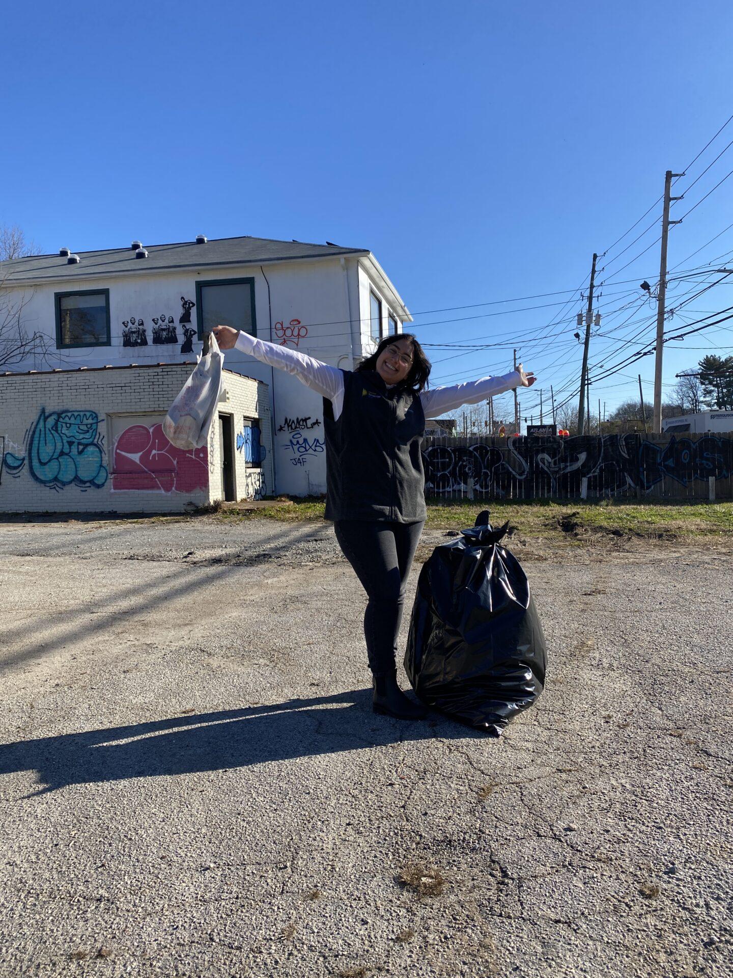 Better Tomorrow Solar crew member nest to a black plastic bag